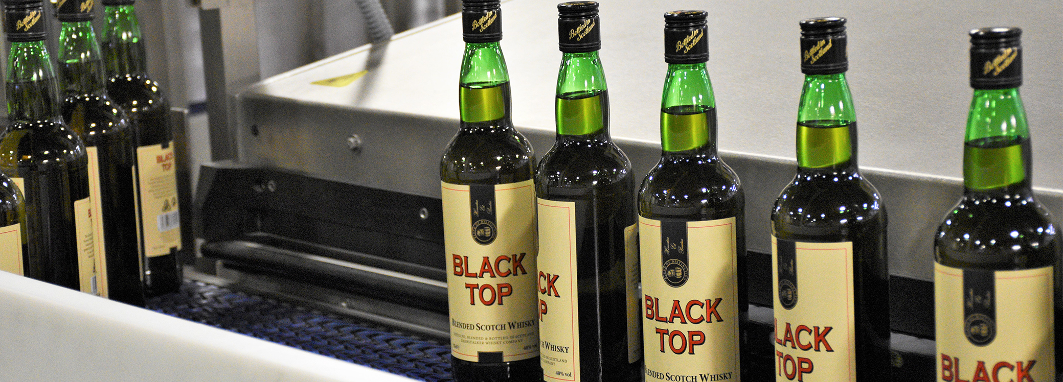 Black Top Blended Scotch Whisky bottles on production line